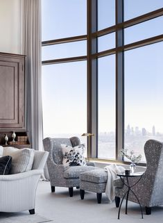 Mandarin Atlanta residence Large window with drapery Wing chairsSkyline view Great Room Living Architectural Detail Contemporary TraditionalNeoclassical Transitional by Lauren DeLoach Interiors