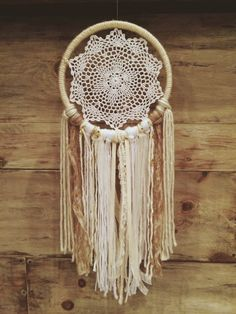 A personal favorite from my Etsy shop https://www.etsy.com/listing/257739883/white-doily-dream-catcher