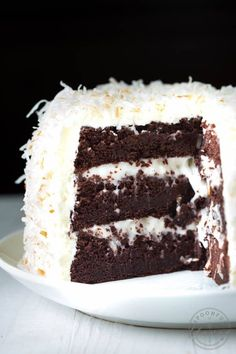Chocolate Cake with Coconut Cream Filling and Marsallow Buttercream Frosting - the perfect cake recipe for birthdays, holidays, parties and more!