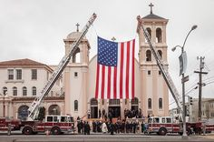 San Francisco fire trucks hoist a U.S. flag in front of St. Monica's Church during a 9/11 memorial mass in San Francisco. Military veterans now serving as S.F. firefighters participated in memorial events throughout the city, and similar remembrances were held throughout the Bay Area. 📷: @SantiMejia_ #911 #911memorial #Sept11 #Sept11memorial #flag #unitedstates #sanfrancisco #church