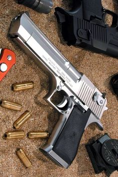 Desert Eagle ~ Stainless Steel Easily my favorite hand gun.