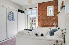 love the exposed brick..... wall sticker would be cool...idk though?