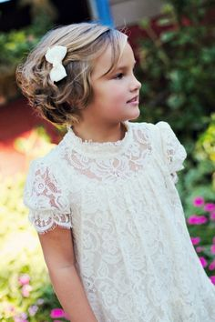 flower girl dress with lace detail and cap sleeves