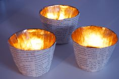 Paper mache votive lights made with old book pages and gold spray paint. Via Rotkehlchen - http://rotkehlchens.blogspot.de/2012/03/diy-recycle-old-books-golden-candles.html