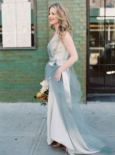 This Carol Hannah custom gown is a 4-ply crepe trumpet gown with crystal embellishment. The dress also has tulle overlay in light silver. The dress was crafted to fit a 5' tall, petite frame.