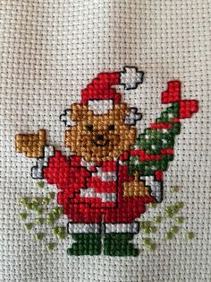 Cross stitch project completed over 2 afternoon / evening sessions. Christmas card or bauble.