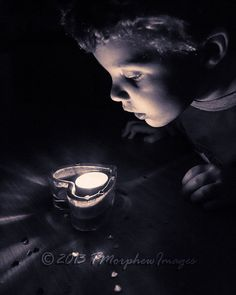 Child fascinated by candle light.  www.tmorphewimages.co.uk