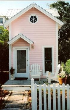 Sweet narrow pink cottage.