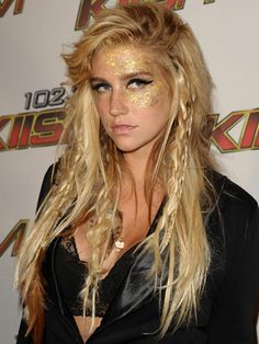 An interesting piecey, tousled look. Looks like a mix of English braids, rope braids, and about a quarter can of texturizer with some hairspray on top. Ke$ha