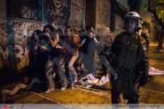 Riot police attack students outside Athens Polytechnic, Greece.