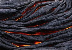 Pahoehoe lava darkens into ropy strands in Hawaii Volcanoes National Park.