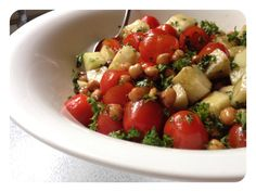 Tomato, Cucumber and Garbonzo Bean Salad.... Served next to grilled white fish would be excellent!