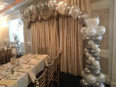 elegant silver and white spiral columns and string of pearls arch decor idea for engagement or weddings