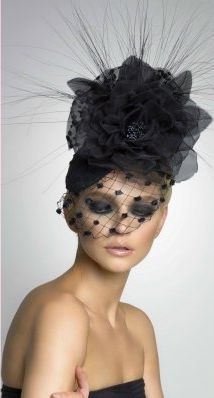 Arturo Rios - Annabelle, Collection 2013. - great elements here: the large flower, the detailed veiling, the filaments at the top. what makes this work in particular though is the smoky eye make-up. society girl meets femme fatale.