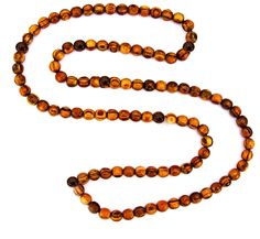 Sandalwood & Rosewood Necklace 3mm- available for $5.50 at http://store.chopra.com/productinfo.asp?item=570=636#