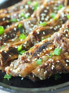Korean Short Ribs - Traditional Korean recipe. Short ribs are marinated in a sweet soy sauce and grilled to perfection. #ribs #korean #july4