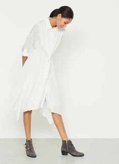 A must have for your wardrobe is this versatile ivory stripe shirt dress. In a flattering shape, featuring a tie front and draped hem. The length from side neck point to front hem measures 100cm/39in.
