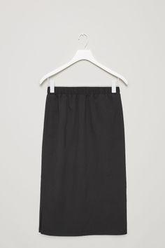 COS image 2 of Mid-length wool skirt in Black