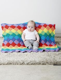 Make up this tunisian crochet blanket in a rainbow color scheme to make a perfect baby blanket