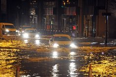 Cars drive through floodwater by the new shopping centre at Kirkstall Bridge in Leeds after the River Aire burst its banks. Flood Warning, Colouring Pics, West Yorkshire, Shopping Center, Leeds, Banks, Centre, Bridge, River