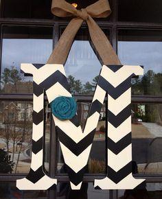 Hey, I found this really awesome Etsy listing at https://www.etsy.com/listing/170134613/door-hanger-wooden-initial-burlap-bow