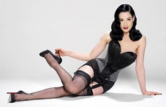 Dita Von Teese...I love the outfit, the hair, the shoes....even the shade of lipstick! Dare to wear this on my wedding night or some time during my honeymoon, oh you betcha my handsome fella! ^_~