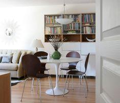 Ikea 'Docksta' tulipe table with Arne Jacobsen chairs & 'Besta' bookcase