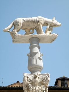 The mythological she-wolf with Romulus and Remus. Images of the she-wolf can be found all over Siena, Italy.