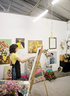 Laura Jones in her studio.  Flowers by Mikarla Shailer Bauer of Rococo Flowers.  Photo - Carine Thevenau.