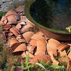 great green garden idea -- Broken Pots    A collection of broken terra-cotta pots was used to cover the grate of the recirculating sugar-kettle fountain.