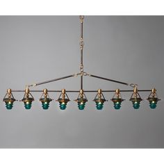 Hester & Cook's light features with charming antique insulators suspended in a brass frame. USA products crafted locally in Nashville, TN with vintage material. How To Make A Chandelier, Rectangular Chandelier, Glass Insulators, Diy Home Improvement, Antique Glass, Vintage Lighting, Pendant Lighting, Wall Lighting, Light Decorations