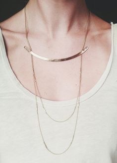 "Hand formed and hammered solid brass arc flanked by custom stamped arrows. Two tiers of vintage segmented brass chain are suspended underneath. Wear the chains over or under shirt.Necklace chain is adjustable by 1.5"" Available with bronze arc as well."