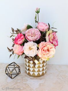 Pink roses that are always in bloom.  Create long lasting floral arrangements with silk roses from Afloral.com.