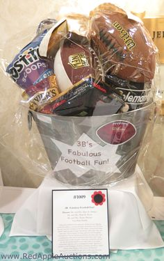 I imagine the winning bidder will put ice and drinks in this metal container during football season. Fundraiser Baskets, Raffle Baskets, Theme Baskets, Themed Gift Baskets, Auction Projects, Auction Ideas, Football Gift Baskets, Silent Auction Baskets, Holiday Market