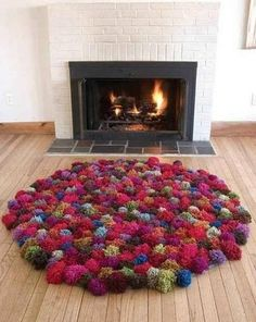 She Wraps Yarn Around Her Fingers. Hours Later, She Creates Something Beautiful http://www.wimp.com/make-diy-rug-made-of-yarn/