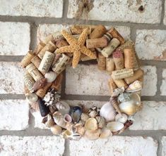 This wine cork wreath is decorated with seashells found along the Texas and Florida Gulf Coasts. Would look great on your front door or in your kitchen or bar area! This wreath is 12 inches outside diameter. Wine Craft, Wine Cork Crafts, Wine Bottle Crafts, Wine Bottles, Bottle Candles, Wine Cork Wreath, Wine Cork Art, Wine Corks, Seashell Crafts