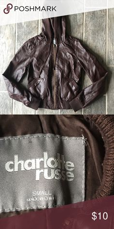 Brown Faux Leather Jacket Dark brown imitation leather jack from Charlotte Russe. Stretch cloth band around waist and wrists. Zip Up and hooded. No flaws other than a very small amount of piling on the waistband and sleeves.   I LOVE OFFERS! I will consider any offer on any item within reason.   🚦50% OFF WHEN PURCHASED WITH ANY PIECE OF JEWELRY🚦 Charlotte Russe Jackets & Coats Utility Jackets