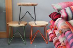 Jamey Garza's wood and steel stacking stools. via @Remodelista (and i adore those pillows!)