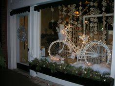 We were talking about bikes and consignment / resale shopping at http://auntiekate.wordpress.com/2013/10/29/rolling-to-resale-success/ : here's one for a holiday window (switch out the winter-specific props, add summer-specific, and what a great 4th of July window too!)