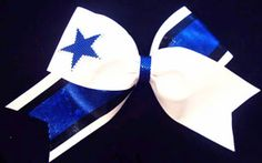 The+Tick+Tock+Rhinestone+Star+Bow+has+alot+of+eye+appeal.+This+is+a+prettier+style+of+cheerleading+bow.+With+alot+of+contrast+in+the+fabrics+and+colors+your+new+cheer+bow+will+be+pretty+no+matter+which+color+combinations+you+choose.
