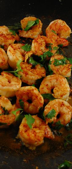 Cilantro Lime Shrimp with Paprika. Cook shrimp in canola oil on medium heat. When nearly done,(1 1/2 minutes), throw in 2 tbsp of lime juice and sprinkle with chopped cilantro and shake on some sweet paprika. Easy and tasty!