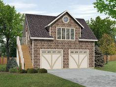 Shake siding decorates this garage apartment that has space for two cars.