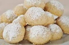 These melt-in-your mouth, shortbread-like cookies go by many names; a Russian Tea Cake, a Mexican Wedding Cake, an Italian Butter Nut, a Southern Pecan Butterball, a Snowdrop, a Viennese Sugar Ball and a Snowball.  From Joyofbaking.com With Demo Video