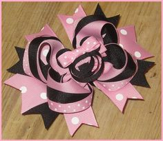 Minnie Mouse hair bow from ETSY, gotta have this for my Sofia's 2nd B-Day party!