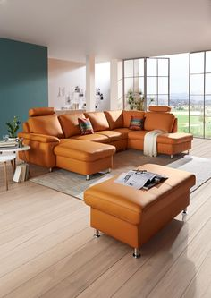 Farbe Füru0027s Wohnzimmer! Die In Orange Gefärbte Wohnlandschaft Ergänzt Den  Raum Stilvoll Und Bietet Zudem