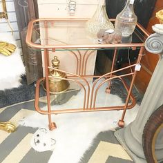 Moved my sweet copper cart into the booth @curiositiesvintage today!