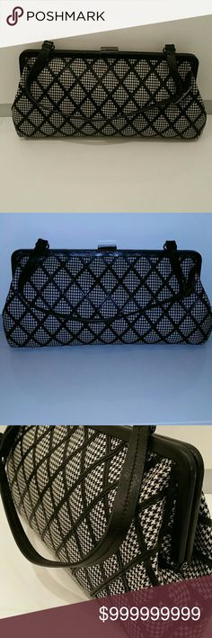 """Nicole Miller Handbag - B&W Houndstooth Baguette Nicole Miller Handbag - B&W Houndstooth. Single strap; adjustable length with buckle strap. Clasp top. Hinged satchel mouth opens wide; practical. Black interior lining. Excellent condition. Very clean. A minor discoloration on the body; very minor signs of wear. Classic design. Versatile. Can be carried as a clutch, a shoulder bag, or on your arm. Fine black leather finishes. Dimensions: 14""""x 7"""" Nicole Miller Bags"""