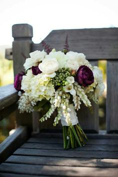 Beautiful Wedding Bouquet: White Hydrangea, White Andromeda, White & Ivory Roses, White Freesia, Red/Purple Astilbe, Dark Purple Cabbage Roses, Green Hypericum & Green China Berry, Hand Tied With White Ribbon