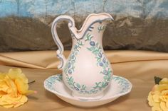 ceramic pitcher and bow