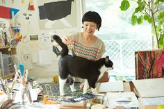 Miroko Machiko , children's book illustrator , with her cat / studio assistant. . Image from http://ilove.cat/wp-content/uploads/2013/10/0393.jpg.